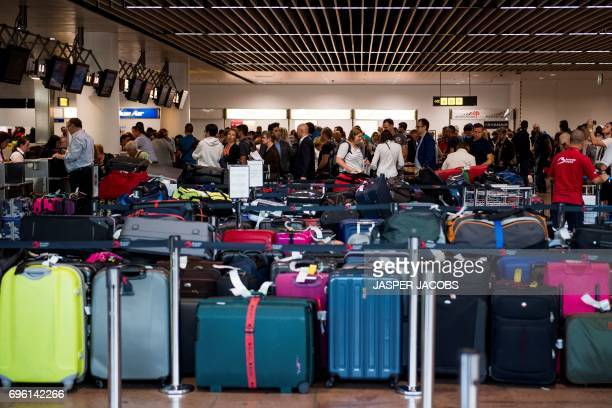 Luggages ready for shipment are seen during a power outage at Brussels Airport in Zaventemon June 152017 / AFP PHOTO / BELGA / JASPER JACOBS /...