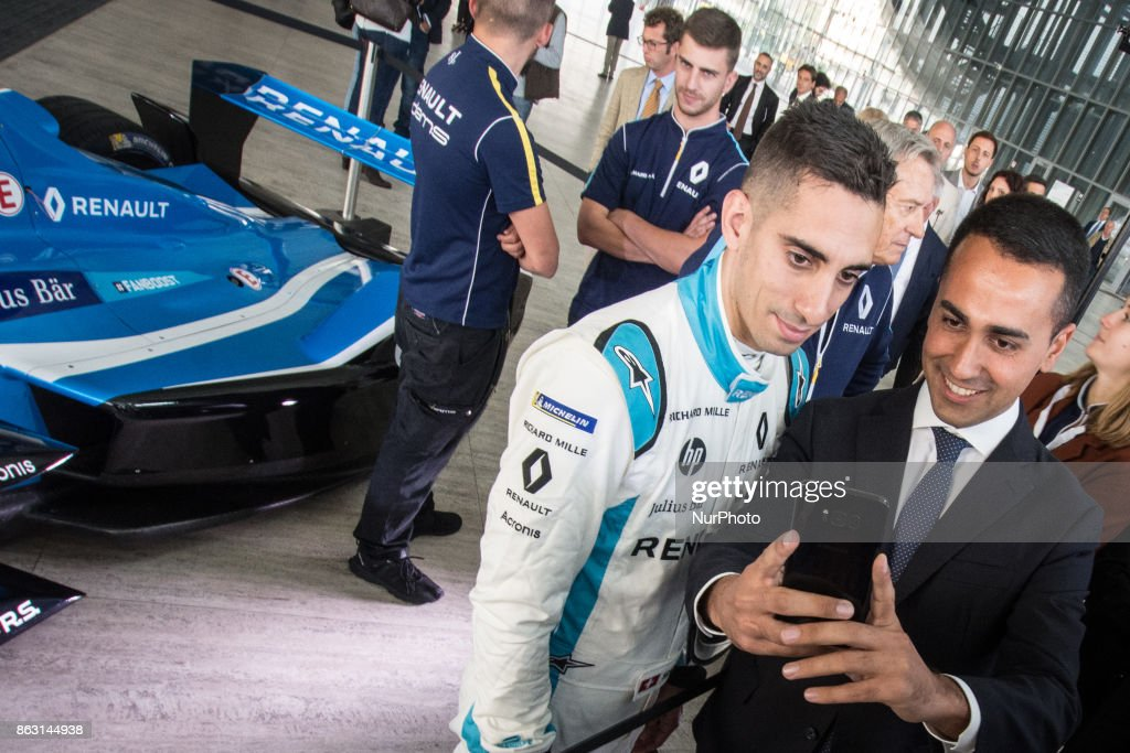 Lugi Di Maio (R) and , Sebastien Buemi (L) take a photo during a Formula E racing car press conference in Rome, Italy on October 19, 2017. Rome will be hosting a Formula E world championship race next April 2018.