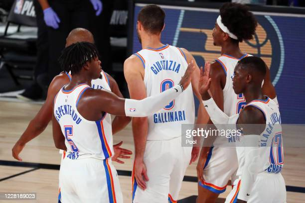 Luguentz Dort celebrates with Dennis Schroder of the Oklahoma City Thunder after defeating the Houston Rockets in game four of the first round of the...
