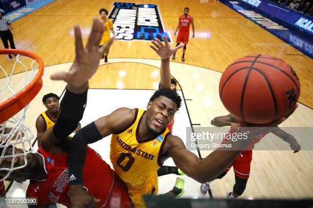 Luguentz Dort of the Arizona State Sun Devils drives to the basket against Sedee Keita of the St John's Red Storm during the first half in the First...