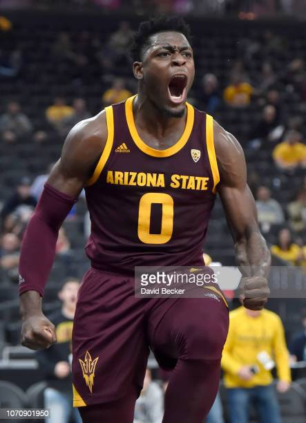 Luguentz Dort of the Arizona State Sun Devils reacts after dunking the ball against the Utah State Aggies during the second half of the championship...