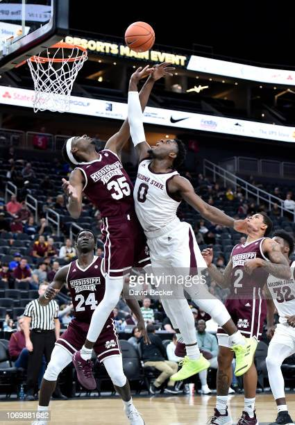 Luguentz Dort of the Arizona State Sun Devils shoots against Aric Holman of the Mississippi State Bulldogs during the first half of a semifinal game...
