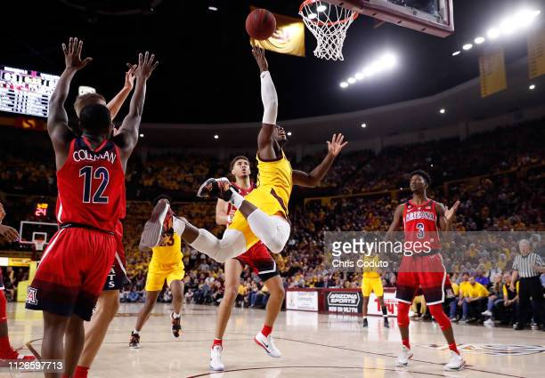 Luguentz Dort of the Arizona State Sun Devils shoots over Chase Jeter of the Arizona Wildcats during the second half of the college basketball game...