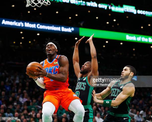 Luguentz Dort of the Oklahoma City Thunder drives to the basket during the first quarter of the game against the Boston Celtics at TD Garden on March...