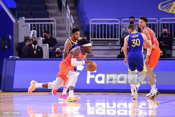 Luguentz Dort of the Oklahoma City Thunder drives to the basket against the Golden State Warriors on April 8, 2021 at Chase Center in San Francisco,...