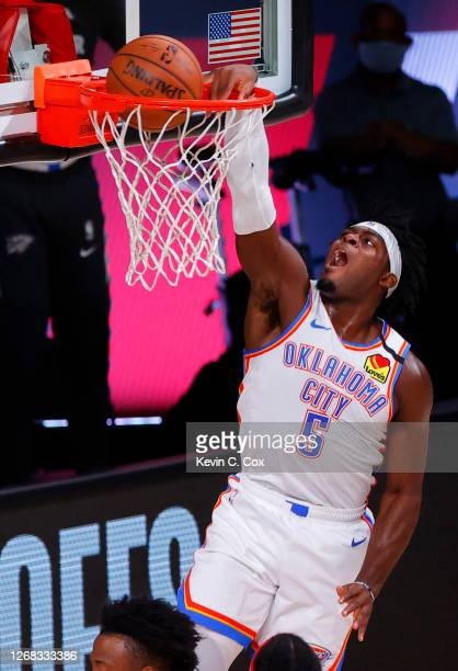 Luguentz Dort of the Oklahoma City Thunder dunks against the Houston Rockets during the first quarter in Game Four of the Western Conference First...