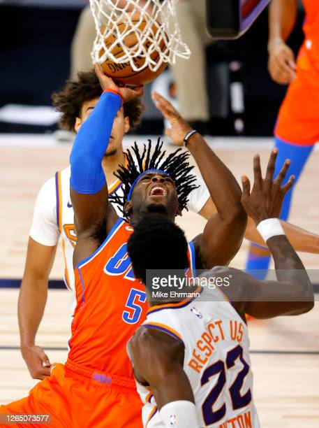 Luguentz Dort of the Oklahoma City Thunder goes up for a shot against Deandre Ayton of the Phoenix Suns during the second quarter at The Field House...
