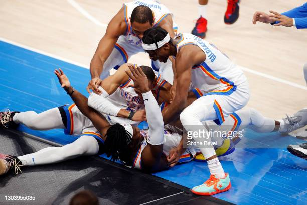 Luguentz Dort of the Oklahoma City Thunder is dog piled by his teammates after hitting a three pointer at the buzzer to defeat the San Antonio Spurs...