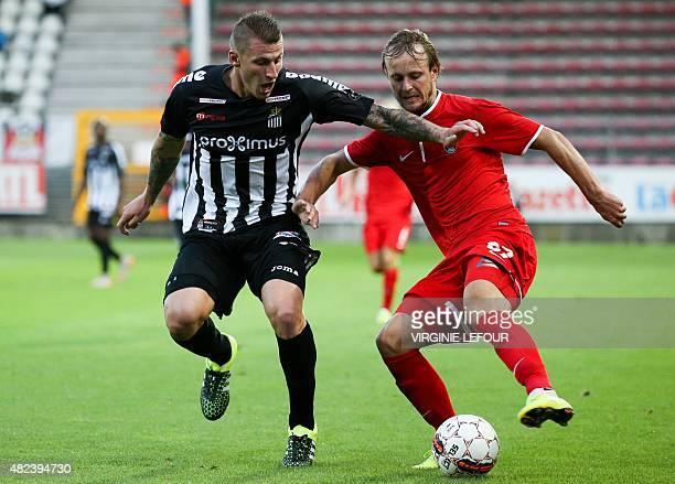Luhansk's defender Dmytro Khomchenovskyi and Charleroi's defender Sebastien Dewaest vie for the ball during the UEFA Europa League third qualifying...