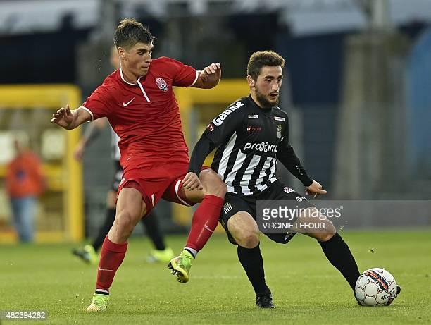 Luhansk's Ruslan Malinovskiy and Charleroi's Enes Saglik vie for the ball during the UEFA Europa League third qualifying round footbal match between...