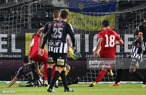 Luhansk's Ruslan Malinovskiy scores a goal during the UEFA Europa League third qualifying round footbal match between Sporting Charleroi and FC Zorya...