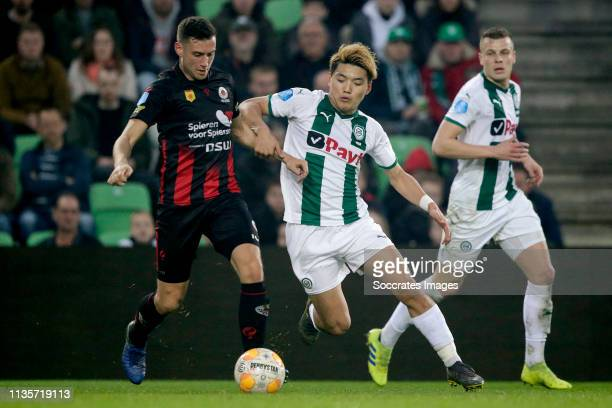 Luigi Bruins of Excelsior Ritsu Doan of FC Groningen during the Dutch Eredivisie match between FC Groningen v Excelsior at the Hitachi Capital...