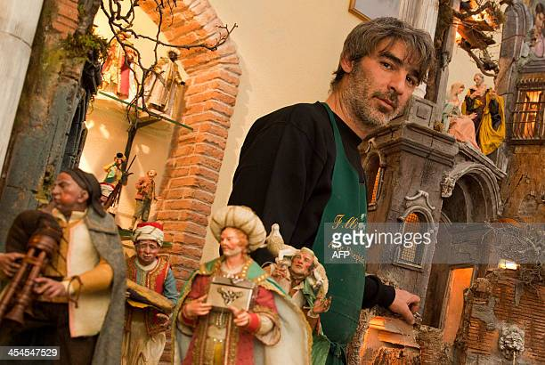 Luigi Capuano poses with crib figurines in his workshop Via San Gregorio Armeno a narrow street often called the street of nativity workshops or...