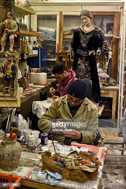 CONTENT] Luigi Cesarini and his son Giuseppe working at the handmade crib figurines in their workshop Via San Gregorio Armeno in Napoli They perform...