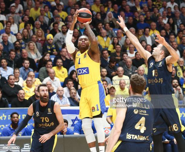 Luigi Datome Nicolo Melli and Kostas Sloukas of Fenerbahce Dogus in action against Deshaun Thomas of Maccabi Fox Tel Aviv during Turkish Airlines...