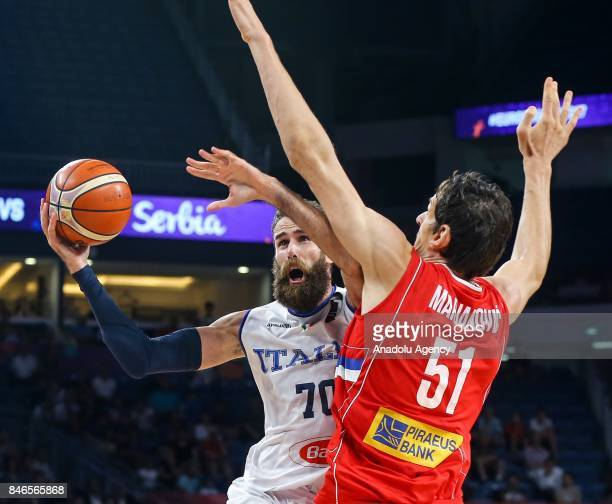 Luigi Datome of Italy in action against Boban Marjanovic of Serbia during the FIBA Eurobasket 2017 quarter final basketball match between Italy and...