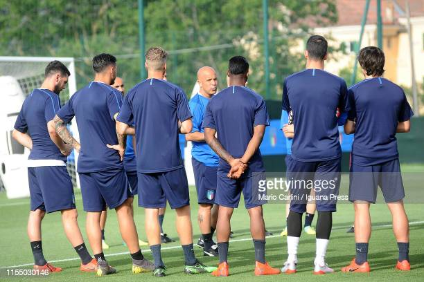 Luigi Di Biagio head coach of Italy U21 National Football Team talks to his players prior the beginning of the training session at Casteldebole...