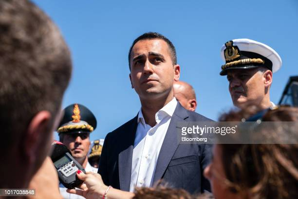 Luigi Di Maio Italy's deputy prime minister speaks to the media as he visits the Morandi motorway bridge after it partially collapsed in Genoa Italy...