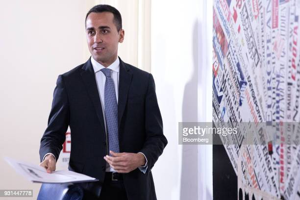 Luigi Di Maio leader of Italy's antiestablishment Five Star Movement arrives to speak at a news conference in Rome Italy on Tuesday March 13 2018...