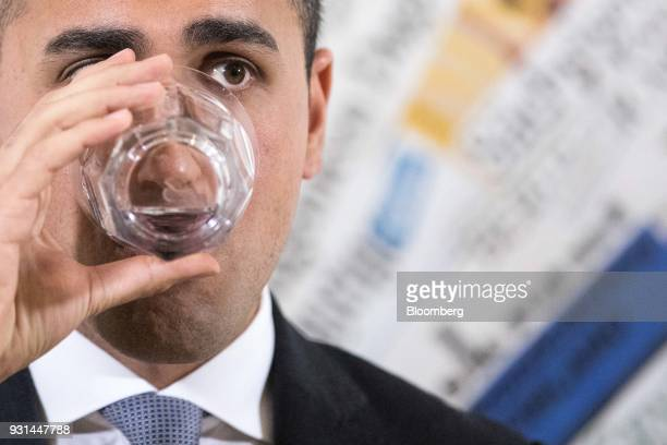 Luigi Di Maio leader of Italy's antiestablishment Five Star Movement drinks from a glass at a news conference in Rome Italy on Tuesday March 13 2018...