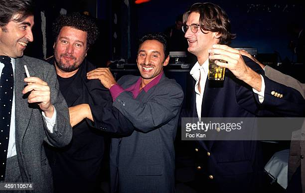 Luigi d'Urso, Philippe Starck, Albert Grintuch and Frederic Beigbeder attend a fashion week Party at Les Bains Douches in the 1990s in Paris, France.