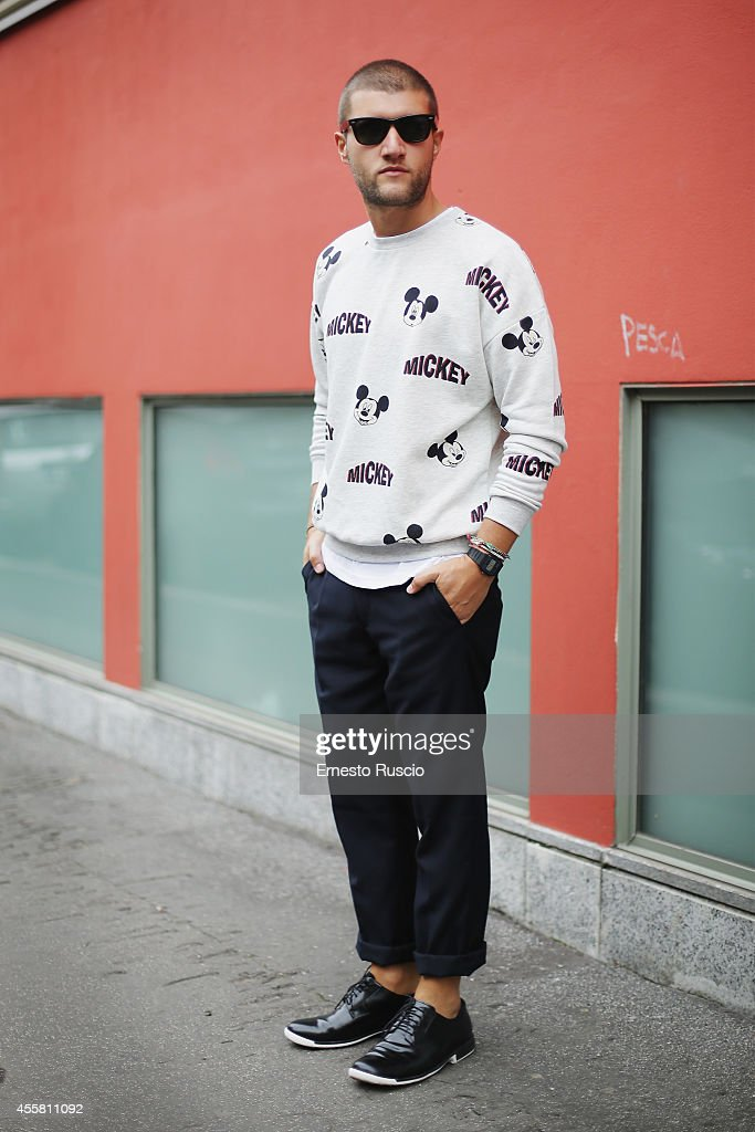 Luigi Frajese poses wearing a Bershka t-shirt, Camper shoes and Ray Ban sun glasses during the Armani fashion Show as a part of Milan Fashion Week Womenswear Spring/Summer 2015 on September 20, 2014 in Milan, Italy.