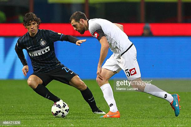 Luigi Giorgi of AC Cesena is challenged by Pires Ribeiro Dodo of FC Internazionale Milano during the Serie A match between FC Internazionale Milano...