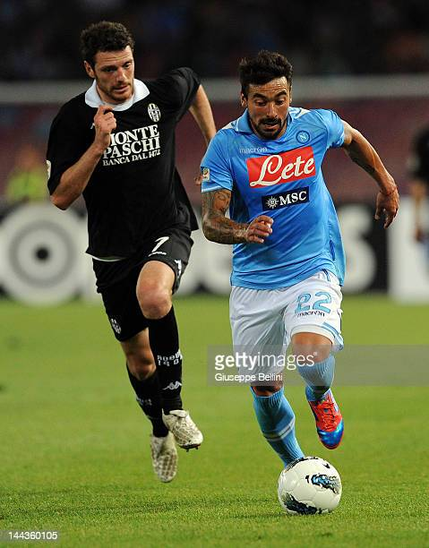 Luigi Giorgi of Siena and Ezequiel Lavezzi of Napoli in action during the Serie A match between SSC Napoli and AC Siena at Stadio San Paolo on May 13...