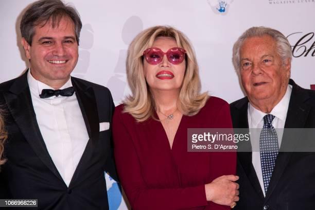 Luigi Lauro Amanda Lear Massimo Gargia attends The Children For Peace Gala at Hotel Principe di Savoia on November 30 2018 in Milan Italy