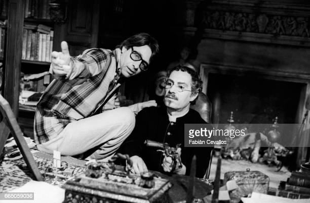 Luigi Magni directs Italian actor Nino Manfredi dressed as a priest on the set of the 1978 movie In Nome Dil Papa Re