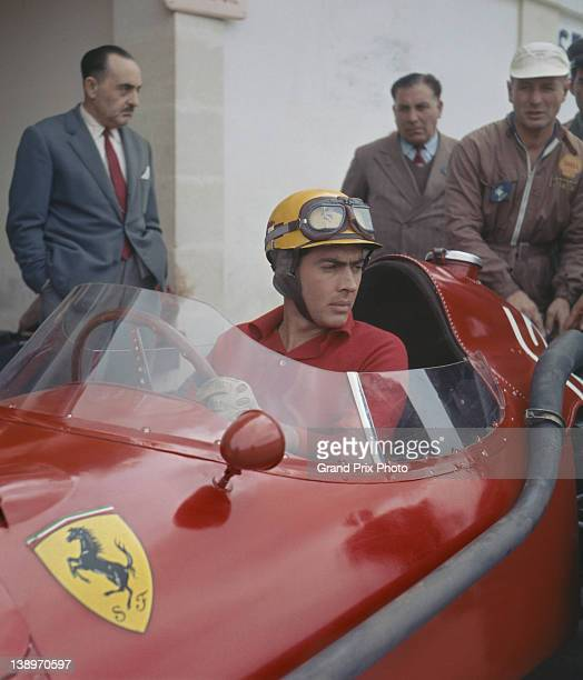 Luigi Musso of Italy sits aboard the Scuderia Ferrari Ferrari 801 in the pits during practice for the French Grand Prix on 6th July 1957 at the...
