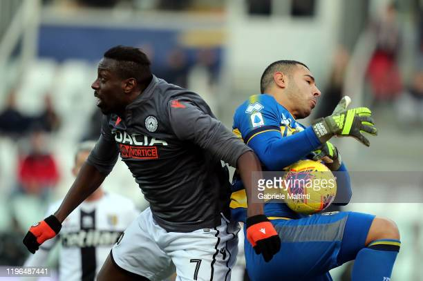 Luigi Sepe of Parma Calcio battles for the ball with Stefano Okaka of Udinese Calcio during the Serie A match between Parma Calcio and Udinese Calcio...