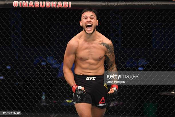 Luigi Vendramini of Brazil celebrates after defeating Jessin Ayari in their lightweight bout during the UFC Fight Night event inside Flash Forum on...