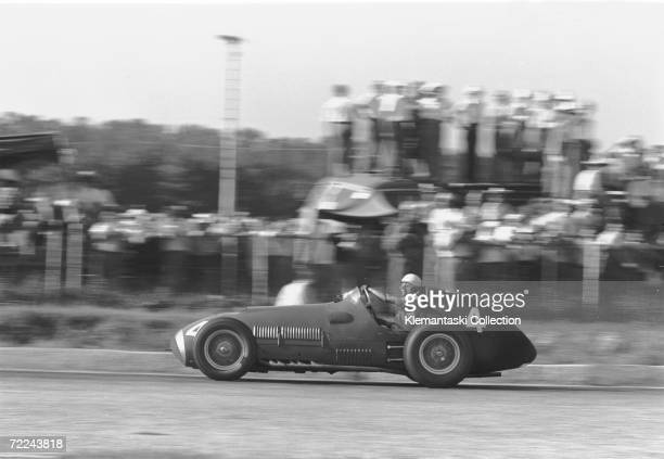 Luigi Villoresi driving his 1951 Ferrari 375 F1 in the Porfido curve at Monza during the Italian Grand Prix, 16th September 1951. He finished fourth.
