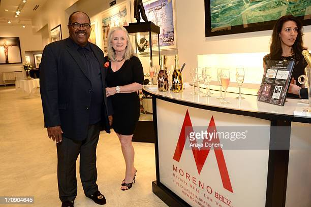 Luins H Williams Jr and Maureen McQuiston Williams attend a gallery exhibit of Terry O'Neill Presents The Opus A 50 Year Retrospective at Mouche...