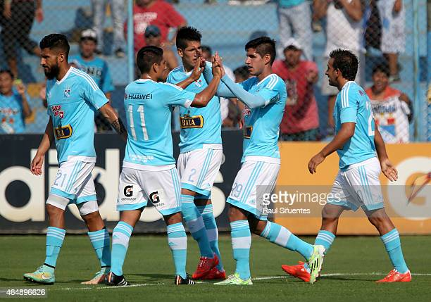 Luis Abram of Sporting Cristal celebrates with his teammates after scoring the first goal of his team against San Martin during a match between...