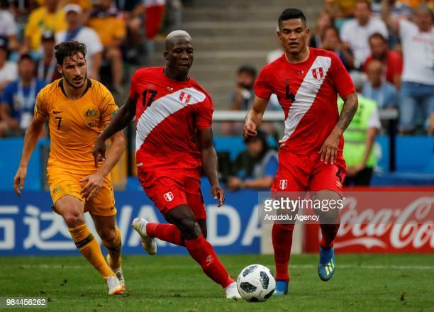 Luis Advincula and Anderson Santamaria of Peru in action against Mathew Leckie of Australia during the 2018 FIFA World Cup Russia Group C match...