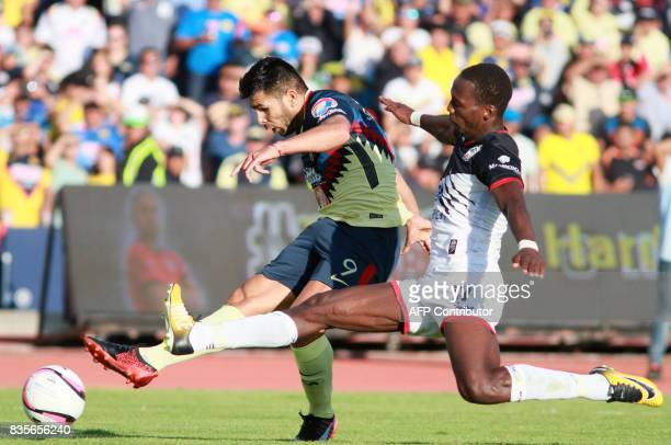 Luis Advincula of Lobos Buap vies for the ball with Silvio Romero of America during their Mexican Apertura 2017 Tournament football match at the...