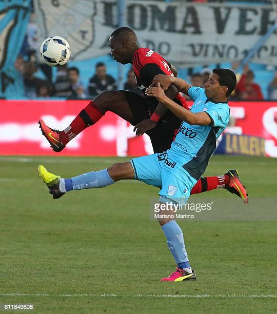 Luis Advincula of Newell's Old Boys fights for the ball with Adrian Arregui of Temperley during a match between Temperley and Newell's Old Boys as...