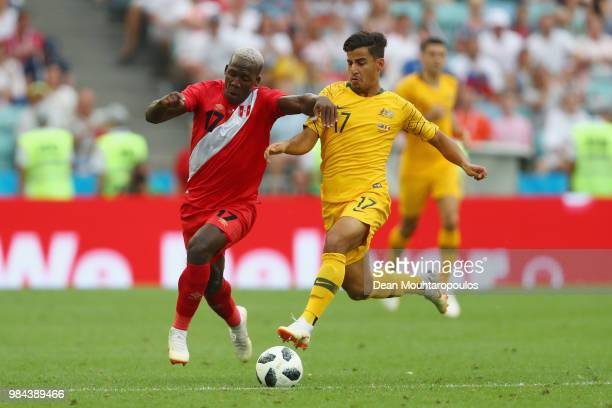 Luis Advincula of Peru and Daniel Arzani of Australia compete for the ball during the 2018 FIFA World Cup Russia group C match between Australia and...