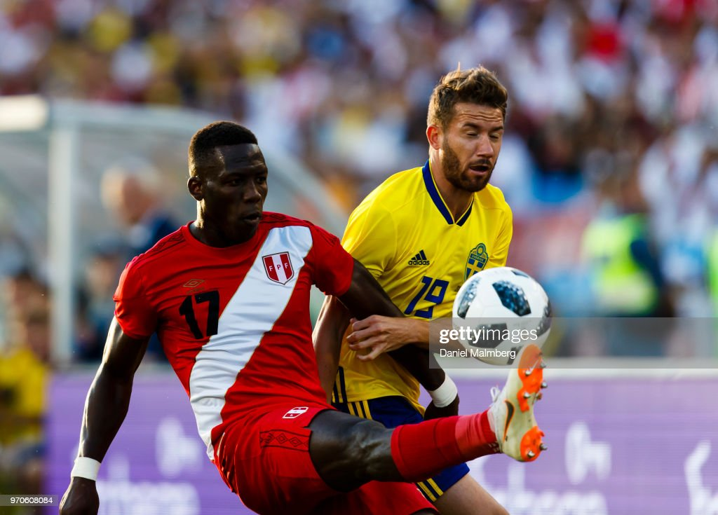 Luis Advincula #17 of Peru and Marcus Rohden #19 of Sweden battle for the ball, during the international friendly match between Sweden v Peru at the Ullevi Stadium on June 9, 2018 in Gothenburg, Sweden.