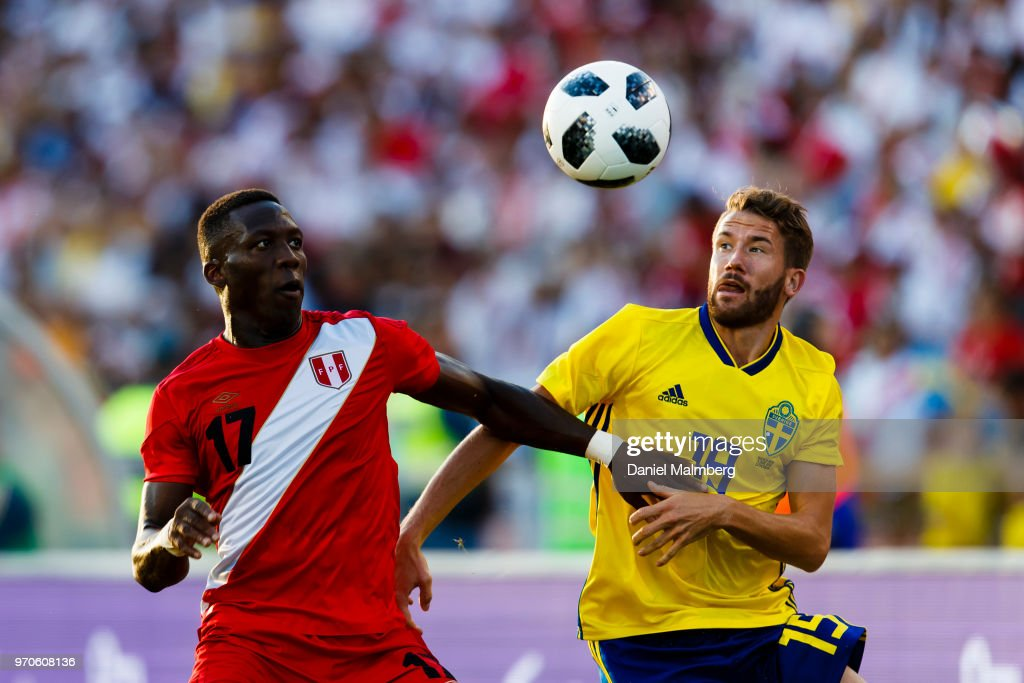 Luis Advincula #17 of Peru and Marcus Rohden #19 of Sweden focused on the ball, during the international friendly match between Sweden v Peru at the Ullevi Stadium on June 9, 2018 in Gothenburg, Sweden.