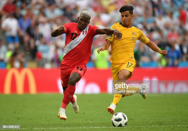 Luis Advincula of Peru battles for possession with Daniel Arzani of Australia during the 2018 FIFA World Cup Russia group C match between Australia...