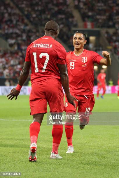 Luis Advincula of Peru celebrates with teammate Yoshimar Yotun after scoring his team's first goal during the International Friendly match between...