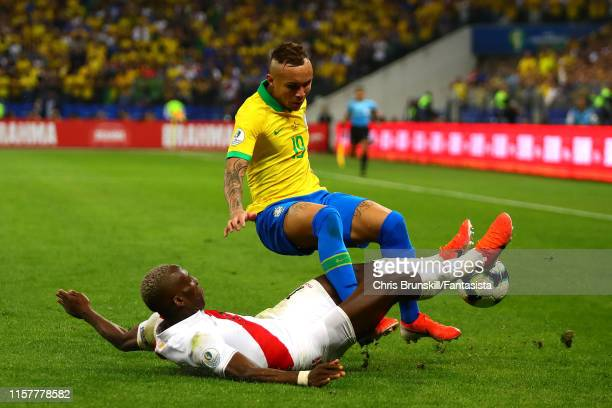Luis Advincula of Peru challenges Everton of Brazil during the Copa America Brazil 2019 group A match between Peru and Brazil at Arena Corinthians on...