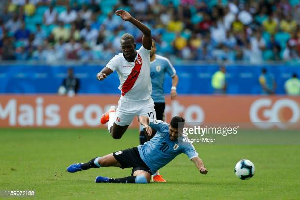 Luis Advincula of Peru fights for the ball with Giorgian De Arrascaeta of Uruguay during the Copa America Brazil 2019 quarterfinal match between...