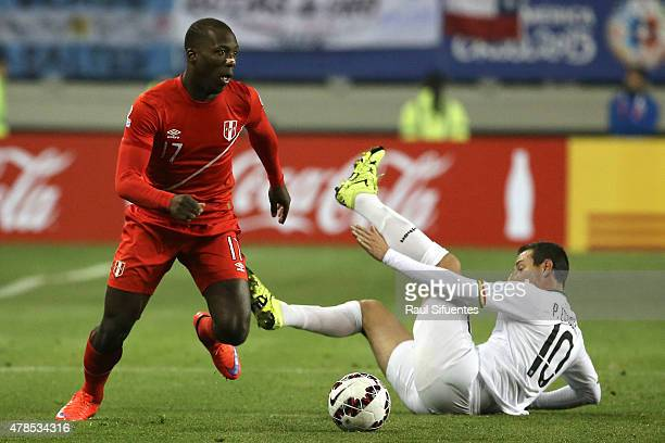 Luis Advincula of Peru fights for the ball with Pablo Escobar of Bolivia during the 2015 Copa America Chile quarter final match between Peru and...