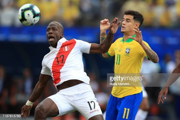 Luis Advincula of Peru fights for the ball with Philippe Coutinho of Brazil during the Copa America Brazil 2019 group A match between Peru and Brazil...