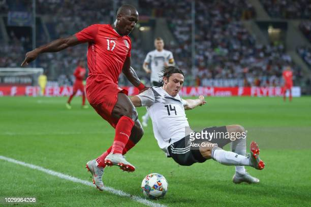 Luis Advincula of Peru is challenged by Nico Schulz of Germany during the International Friendly match between Germany and Peru at Wirsol...