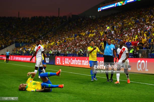 Luis Advincula of Peru is shown the yellow card after fouling Everton of Brazil during the Copa America Brazil 2019 group A match between Peru and...